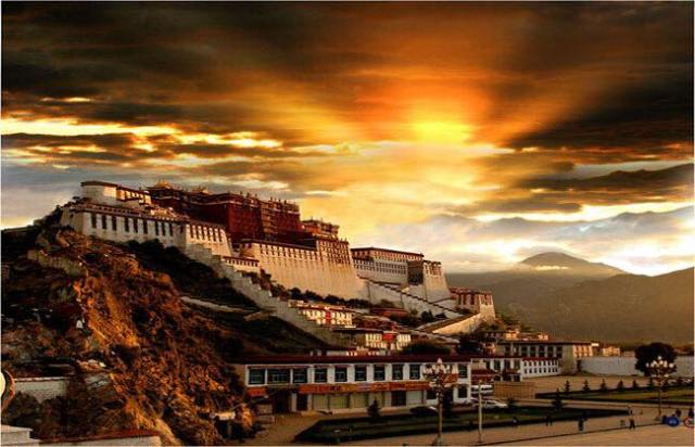 THE RISING SUN - THE LAND OF TIBET : THE SUNRISE AT POTALA PALACE, LHASA GIVES ME A SENSE OF HOPE AND AT THE SAME TIME IT REMINDS ME THAT THERE IS A GREAT CHALLENGE AHEAD OF THAT PROMISE OF HOPE.