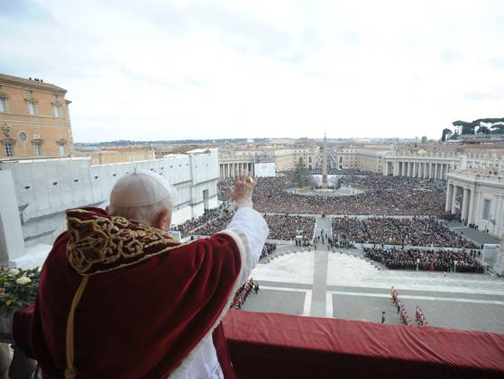 """Pope Benedict XVI delivering the Vatican's traditional Christmas Day """"Urbi et Orbi""""(to the City and to the World) Message from the central balcony of Saint Peter's Basilica on Tuesday, December 25, 2012."""