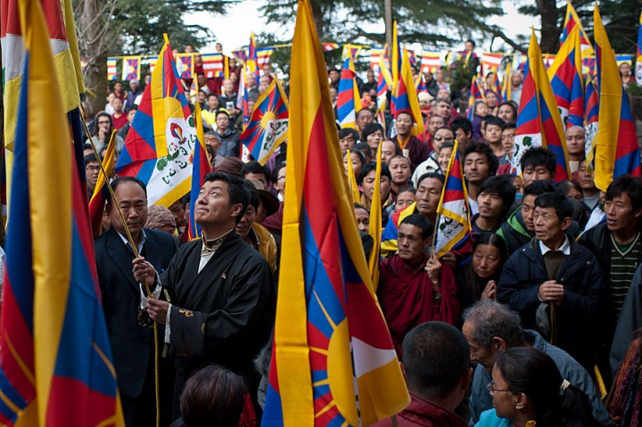 Kalon Tripa Dr. Lobsang Sangay, political head of the Tibetan people, unfurls and raises the Tibetan National Flag on the 53rd National Uprising Day on March 10, 2012 in Dharamsala, India. Tibetan people are demanding their Right to Natural Freedom that was taken away by the military occupation of their Land. Freedom in Tibet is about oppression caused by foreign occupation.