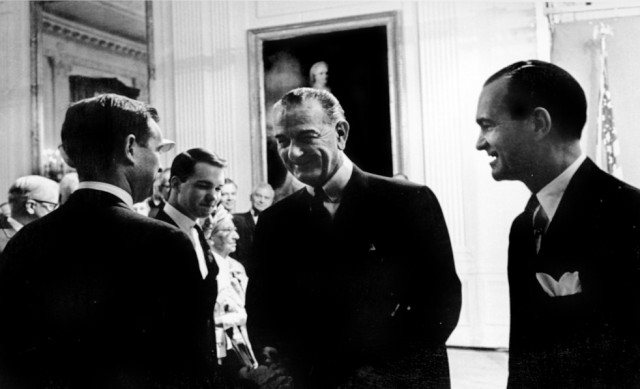 Whole Dude - Whole Spy: Richard Helms was appointed as the eighth Director of CIA on June 30, 1966. In a function held in the East Room, White House, President Lyndon B. Johnson is seen speaking to Dennis Helms, son of the newly sworn in CIA Director.