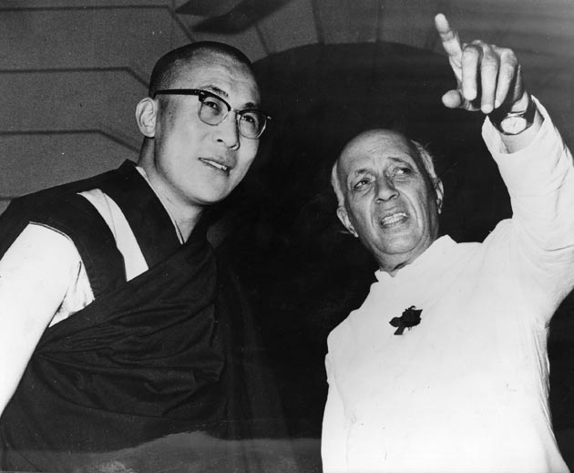 1964 - NEW DELHI. A photo after the 1962 India - China War. Prime Minister Jawaharlal Nehru is seen with His Holiness the 14th Dalai Lama, the Head of Tibetan Government-in-Exile. India firmly stands behind Tibet and along with the United States wants to find solution to the problem of military occupation of Tibet.
