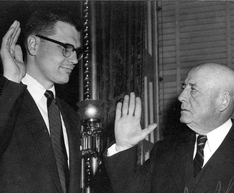 Whole Dude-Whole Representative: Representative John Dingell with the Speaker of the House Sam Rayburn taking his oath to the office in 1955.