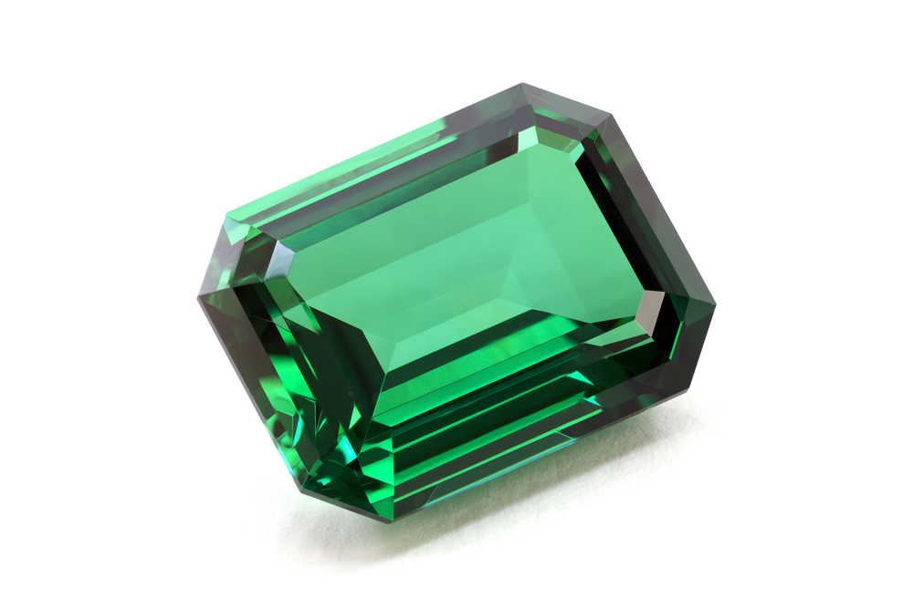 WholeDude - Whole Expose: Emerald is a bright-green, transparent precious stone. It is composed of mineral called Corundum, the green variety that has Beryl or Beryllium compound. Physics can explain the green color of Emerald and the green color of plants. The green color of plants is caused by a substance called Chlorophyll, the only substance in nature that can trap radiant solar energy.