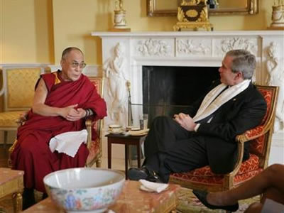 SPECIAL FRONTIER FORCE AT THE WHITE HOUSE: His Holiness the 14th Dalai Lama speaking with US President George Bush during their meeting at The White House in Washington, DC on November 09, 2005.