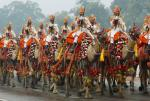 An armed Indian military regiment riding camels march in India's Republic Day parade in New Delhi January 26, 2015.  REUTERS/Jim Bourg (INDIA   Tags: POLITICS ANNIVERSARY)