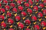 Indian soldiers march during the Republic Day parade in New Delhi January 26, 2015. U.S. President Barack Obama watched a dazzling parade of India's military might and cultural diversity on Monday, the second day of a visit trumpeted as a chance to establish a robust strategic partnership between the world's two largest democracies. REUTERS/Adnan Abidi (INDIA   Tags: ANNIVERSARY MILITARY SOCIETY)