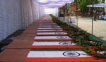 Coffins of Indian Central Reserve Police Force (CRPF) paramilitary soldiers lie draped with the Indian flag under an awning in Jagdalpur on April 7, 2010, a day after 76 police personnel were killed in a brutally effective attack that undermined a months long government offensive against Maoist insurgents.  The massacre, in the central state of Chhattisgarh, was the biggest single blow that the Maoists have landed in their decades long struggle against India's regional and central governments. Home Minister P. Chidambaram, visiting the region, said the Maoists had executed a complex, multi stage ambush in which a patrol was attacked and two sets of reinforcements had then come under heavy fire. AFP PHOTO/STR (Photo credit should read STRDEL/AFP/Getty Images)