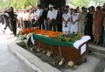 Indian army soldiers salute the coffin bearing the body of Brigadier Ravi Datt Mehta, the military attache who was killed in a Terror attack in Indian embassy in Kabul, as family members look on during a cremation ceremony in New Delhi on July 8, 2008. Indian defence attache, a diplomat and three other Indian staff members at its heavily fortified embassy in Kabul were among the 41 people killed after a suicide bomber rammed an explosive laden vehicle into the mission gates during the morning rush hour.    AFP PHOTO/RAVEENDRAN (Photo credit should read RAVEENDRAN/AFP/Getty Images)