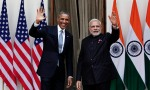 U.S. President Barack Obama and India's Prime Minister Narendra Modi (R) wave during a photo opportunity ahead of their meeting at Hyderabad House in New Delhi January 25, 2015. In a glow of bonhomie, Obama and Modi announced a breakthrough on nuclear trade on Sunday, a step that both sides hope will help establish an enduring strategic partnership. REUTERS/Adnan Abidi (INDIA   Tags: POLITICS)