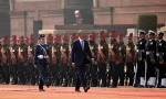 President Barack Obama reviews members of the military during an arrival ceremony at Rashtrapati Bhavan, the presidential palace, in New Delhi, India, Sunday, Jan. 25, 2015. Obama's arrival Sunday morning in the bustling capital of New Delhi marked the first time an American leader has visited India twice during his presidency. Obama is also the first to be invited to attend India's Republic Day festivities, which commence Monday and mark the anniversary of the enactment of the country's democratic constitution. (AP Photo/Carolyn Kaster)