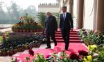 President Barack Obama walks with the Indian Prime Minister Narendra Modi to the gardens of the Hyderabad House in, New Delhi, India, Sunday, Jan. 25, 2015. Seizing on their personal bond, President Barack Obama and Indian Prime Minister Narendra Modi voiced optimism Sunday that they could find common ground on defense, commerce and environmental issues. (AP Photo/Carolyn Kaster)