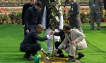 President Barack Obama, left, participates in a tree planting ceremony at the Raj Ghat Mahatma Gandhi Memorial, New Delhi, India, Sunday, Jan. 25, 2015. Seizing on their personal bond, President Barack Obama and Indian Prime Minister Narendra Modi voiced optimism Sunday that they could find common ground on defense, commerce and environmental issues. (AP Photo/Carolyn Kaster)