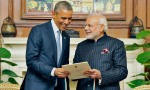 India's Prime Minister Narendra Modi (R) presents a reproduction of telegram sent by U.S. to the Indian Constituent Assembly in 1946, to U.S. President Barack Obama during their meeting in New Delhi January 25, 2015. In a glow of bonhomie, Obama and Indian Prime Minister Narendra Modi worked on a series of bilateral agreements at a summit on Sunday that both sides hope will establish an enduring strategic partnership. REUTERS/India's Press Information Bureau/Handout via Reuters (INDIA   Tags: POLITICS)  ATTENTION EDITORS   THIS PICTURE WAS PROVIDED BY A THIRD PARTY. REUTERS IS UNABLE TO INDEPENDENTLY VERIFY THE AUTHENTICITY, CONTENT, LOCATION OR DATE OF THIS IMAGE. FOR EDITORIAL USE ONLY. NOT FOR SALE FOR MARKETING OR ADVERTISING CAMPAIGNS. THIS PICTURE WAS PROCESSED BY REUTERS TO ENHANCE QUALITY. AN UNPROCESSED VERSION WILL BE PROVIDED SEPARATELY. NO SALES. NO ARCHIVES. NO COMMERCIAL USE
