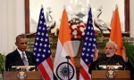 India's Prime Minister Narendra Modi reads a joint statement next to U.S. President Barack Obama (L) at Hyderabad House in New Delhi January 25, 2015. In a glow of bonhomie, Obama and Modi announced a breakthrough on nuclear trade on Sunday, a step that both sides hope will help establish an enduring strategic partnership. REUTERS/Adnan Abidi (INDIA   Tags: POLITICS)