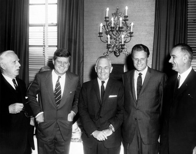 SPECIAL FRONTIER FORCE AT NATIONAL PRAYER BREAKFAST : 1961 PRESIDENTIAL PRAYER BREAKFAST WITH US PRESIDENT JOHN F. KENNEDY, SOUTHERN BAPTIST MINISTER REVEREND BILLY GRAHAM, AND EXECUTIVE DIRECTOR OF INTERNATIONAL CHRISTIAN LEADERSHIP INC., ABRAHAM VEREIDE.
