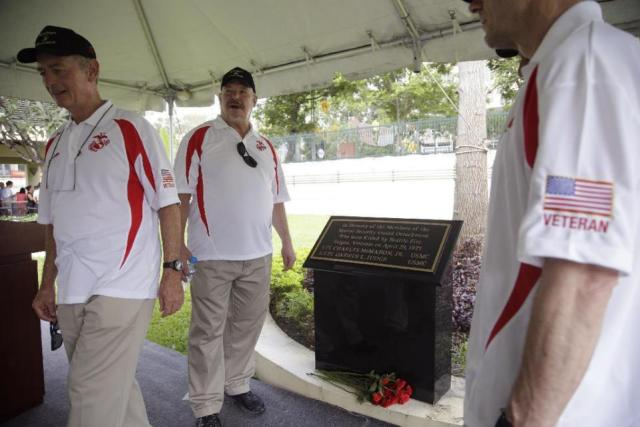 THE  EVIL  RED  EMPIRE  -  THE  FALL  OF  SAIGON :  FORMER  US  MARINES  SGT  KEVIN  MALONEY(LLEFT), LANCE CORPORAL JOHN  STEWART , ATTEND  A  CEREMONY  TO  DEDICATE  A  PLAQUE  TO  THEIR  FALLEN  COMRADES .