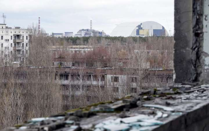 World Remembers 30th Anniversary of Chernobyl Disaster. A view of Safe Containment Shelter from Ghost City of Pripyat, Exclusion Zone, Ukraine.