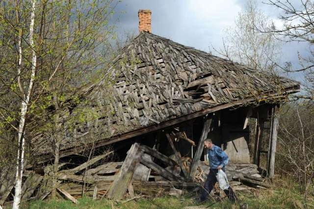 World Remembers 30th Anniversary of Chernobyl Disaster. Ruined house in Vezhishche Village, Exclusion Zone, Ukraine.