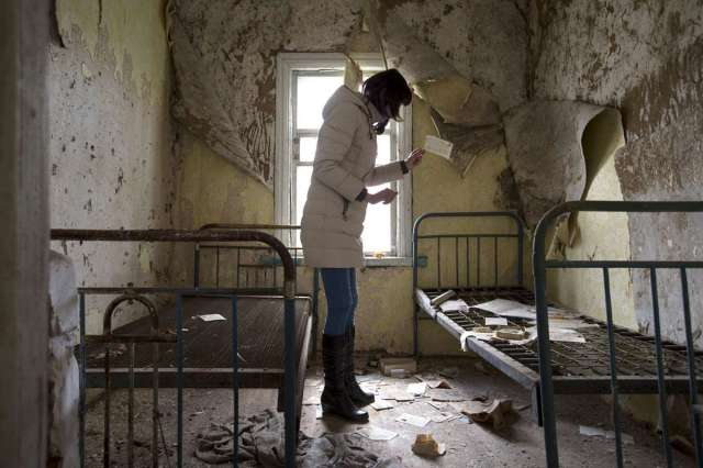 World Remembers 30th Anniversary of Chernobyl Disaster. Revisiting abandoned house in Orevichi Village, Belarus.