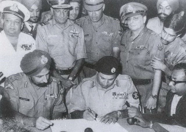 TE3N Movie Review - Indian Army vs Special Frontier Force. Command and Control of Military Organizations. Army Act 1950 does not govern Special Frontier Force Operations. Photo image of Signing of Surrender Agreement in Dhaka on December 16, 1971 appears in TE3N.